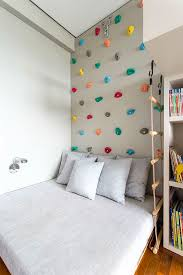 make a climbing wall over kids bed for an easy indoor climbing area the bed