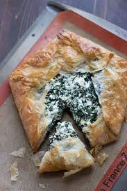 easy spanakopita is filled with feta and spinach and filled surounded by ery phyllo dough