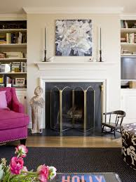 transitional um tone wood floor family room idea in dc metro with beige walls and a