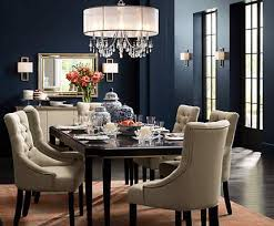 sitting room lighting. a crystal chandelier with silver silk shade adds sparkle to this dining room sitting lighting