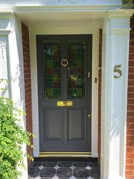 painted timber front door with stained glass panels