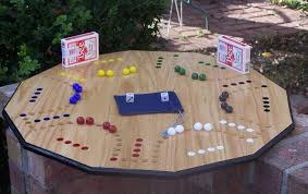Game With Wooden Board And Marbles Aggravation game marble war 100 and 100 player card or dice game 82