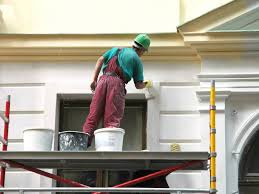 an exterior painter working on a home in roswell