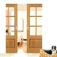 double pocket door kit pocket slide door double pocket dove 6 pane oak sliding door system in three size widths pocket slide door double pocket door