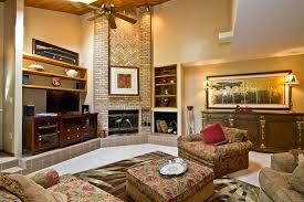 Charming Living Room With Rustic Accent On Floral Couches In ...