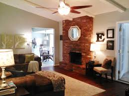 red brick fireplace mantel decorating ideas with mirror above blades ceiling fan lights white area rugs