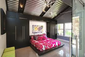 High Ceiling Garage Remodel Into Moden Bedroom Design With Red Flower  Pattern Bed Cover For Low Profile Bed With Wooden Bed Pedestal Black And  Gray Painted ...