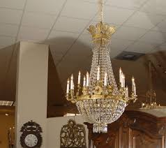 an 18 light chandelier in gilt bronze with strands of cut crystal