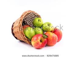 green and red apples in basket. overturned woven basket with fruits typically from southern countries, green and red apples in f