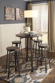 Challiman Round Dining Room Bar Table u0026 4 Tall Stools by Signature Design  by Ashley Get your Challiman Round Dining Room Bar Table u0026 4 Tall Stools  at