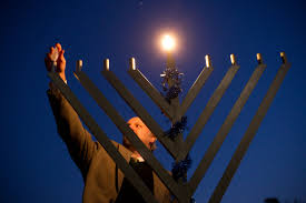 rabbi michael gisser the wake forest ociate chaplain for jewish life leads the lighting of a menorah on manchester plaza on the first day of hanukkah