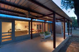 roofed patio design patio contemporary with covered patio teak outdoor dining tables ceiling fan amidst concrete patio near corrugated metal