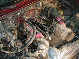 ford explorer ranger 4 0l ohv lifter noise valve clatter fix both valve covers removed and the upper intake manifold here is where you can see that the lifters won t come out out taking off the heads