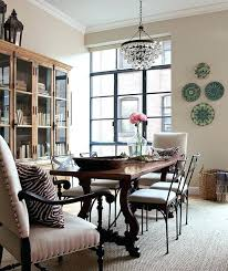 robert abbey chandelier chic city dining room with green blue decorative wall plates abbey bling chandelier robert abbey
