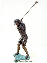 young lady golfer making a swing statue
