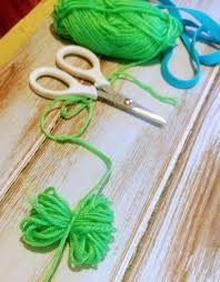 grab your scissors and cut the loops and fluff them out to make poms