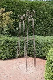 weathered wrought iron garden obelisk