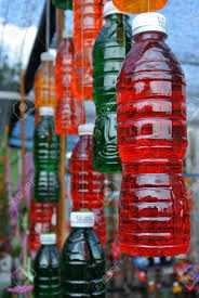 Decorated Plastic Bottles Plastic Bottles Filled With Liquids Of Various Colors And Hung 91