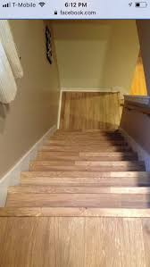 a set of stairs and landing we installed laminate flooring on in chicago 773 447