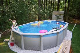 above ground swimming pool designs. Fiberglass Above Ground Swimming Pools Designs For Kids With White Ladder Installed And Stone Beads Around The Pool O