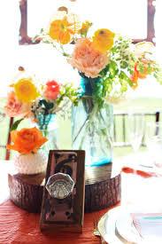 rustic citrus wedding inspiration outdoor spring wedding ideas mason jar  centerpieces