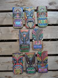 an awesome fair trade wooden tiki mask plaque the tiki masks represent a god or deity from the hawaiian or polynesian culture lots of designs to choose  on tiki mask wall art with fair trade hand carved made wooden dot painted tiki mask wall art