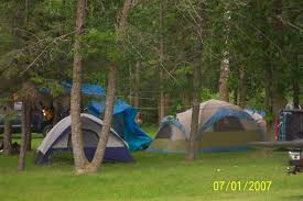lakeside tenting is always an affordable favorite especially for the younger people come people camping in woods26 camping