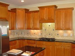image of painted oak kitchen cabinets before and after