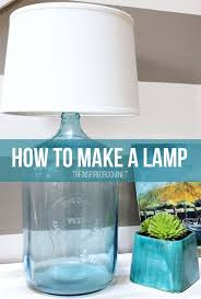 how to make a lamp a super easy tutorial for an affordable and unique lamp made from a big glass water jug found at a thrift