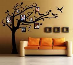 marvelous painting stencil art for walls interior living room design square shelves orange sofa black photos framed