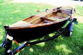 the interior was left natural wood seats bow deck and wales are mahogany with sitka accent the hull is painted with house of color midnight blue pearl
