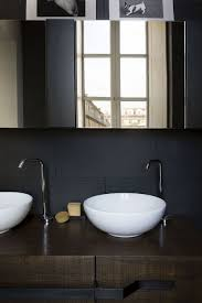 room fabio black modern: view in gallery black backdrop and white sinks along with a wooden vanity in the bathroom