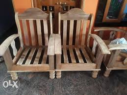 show only image two brown wooden rocking chairs