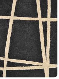geometric hand tufted woolen black cream area rug k02001