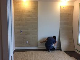 installing faux brick panel