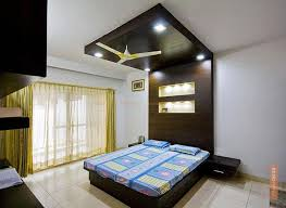wood false ceiling designs: modern bedroom with wood false ceiling