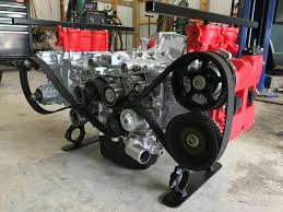 duo of father son builds wrx boxer engine coffee table in wrinkle red touch 17
