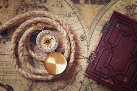 image of old p and rope next to old book on vine map stock image