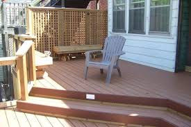 upper level of large mid height 2 level deck with privacy screen