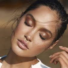 a woman with great bronzer