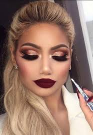 crazy brown and rose gold cut crease with a dark red lip makeup mua