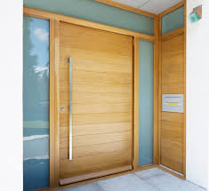 picture of semi solid horizontal slatted pivot door pre hung in frame 1500 x 2032