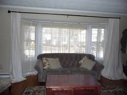 white dry curtains with black curtain rod also large glass