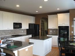 White Galaxy Granite Kitchen White Cabinetry With Darkbrown Island Also Black Granite