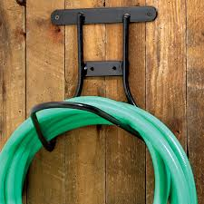 chic garden hose holder crossword