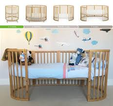 stokke sleepi   in  crib  cot  bed in natural beech colour