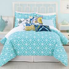 wonderful blue tie dye comforter with bedskirt and decorative pillows on cozy parkay floor