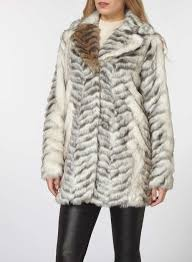 white animal print faux fur coat