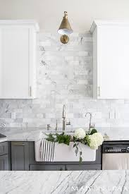white kitchen with carrara marble backsplash maison de pax