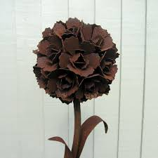 rusted flower sculpture